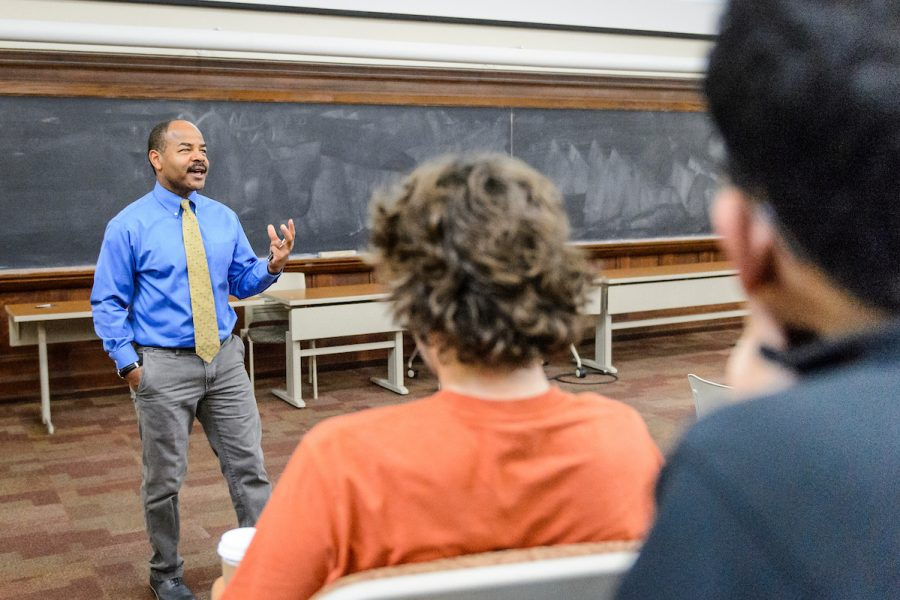 Eric Wilcots, professor stands in front of class lecturing.