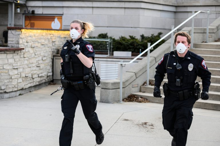 Wearing N95 medical masks, two UW Police Department officers respond to an incident on campus
